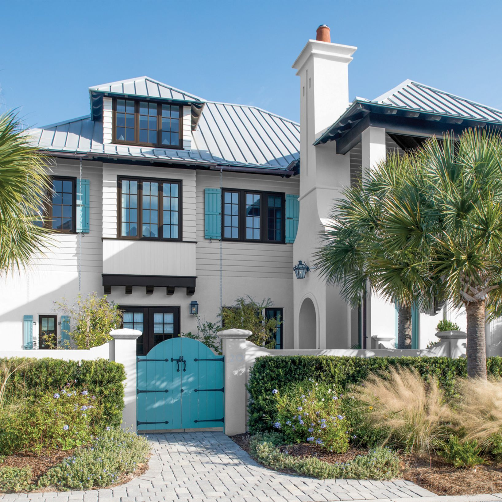 Brown Trimmed House with Turquoise Shutters