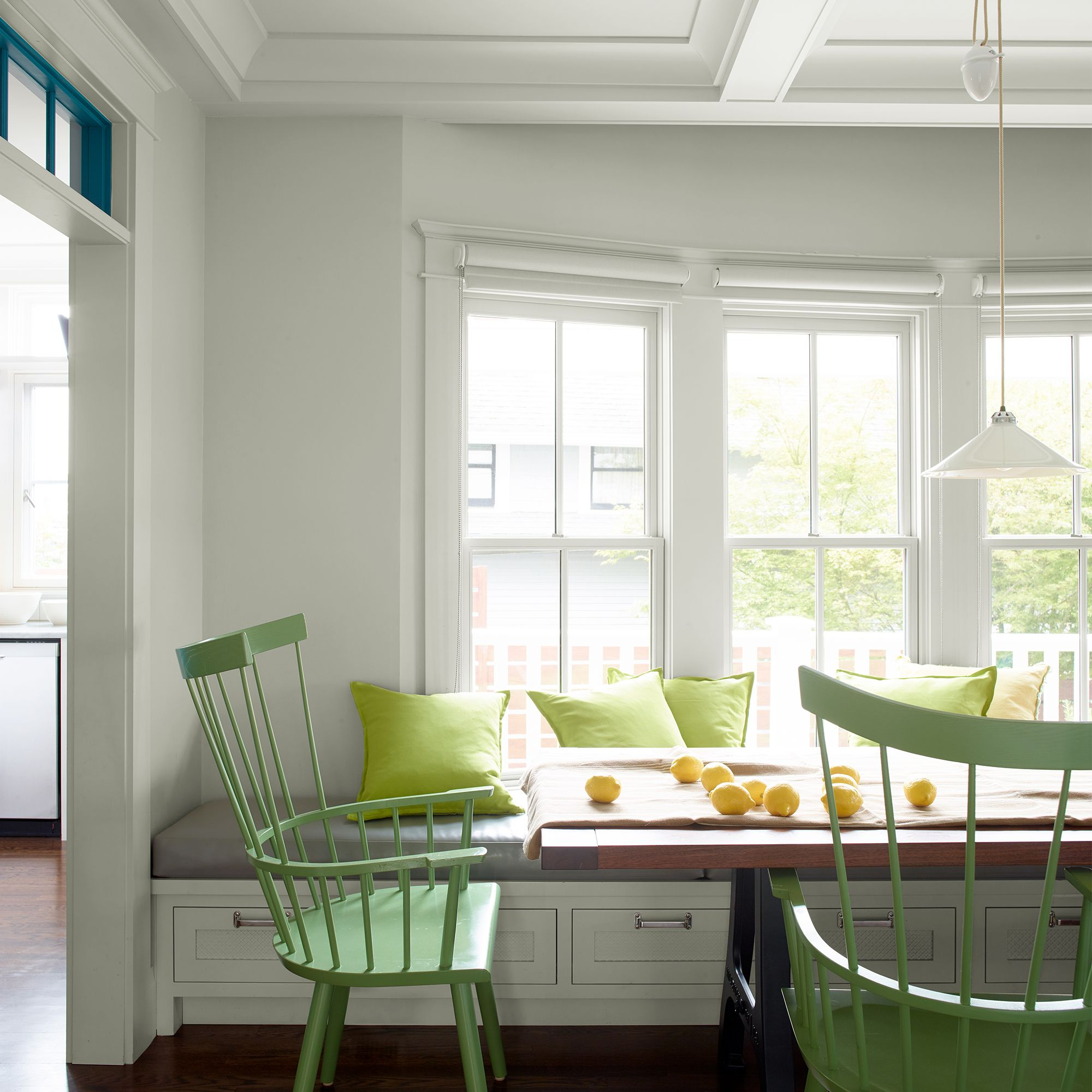 Dining Room with Bay Window and Green Chairs