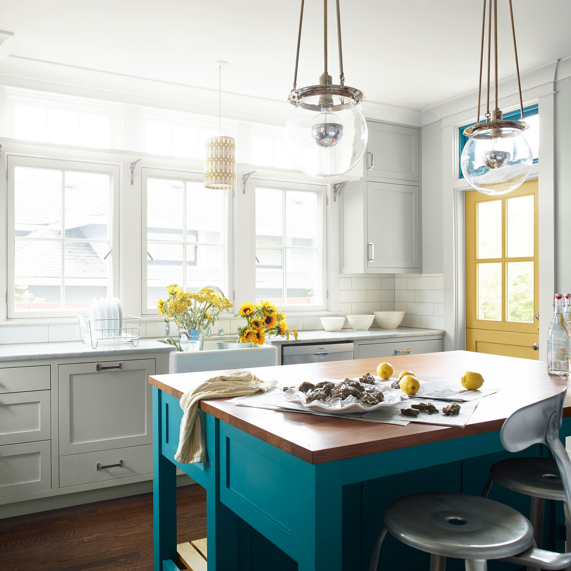 Kitchen with Center Island and White Cabinets