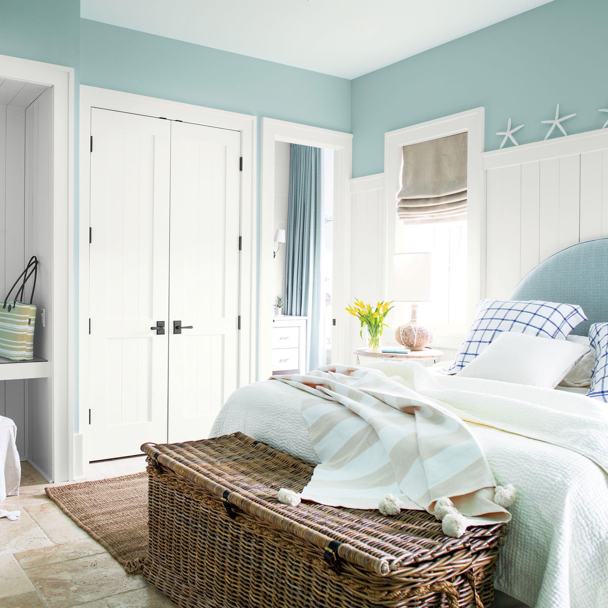 Light Blue Bedroom with Wicker Basket