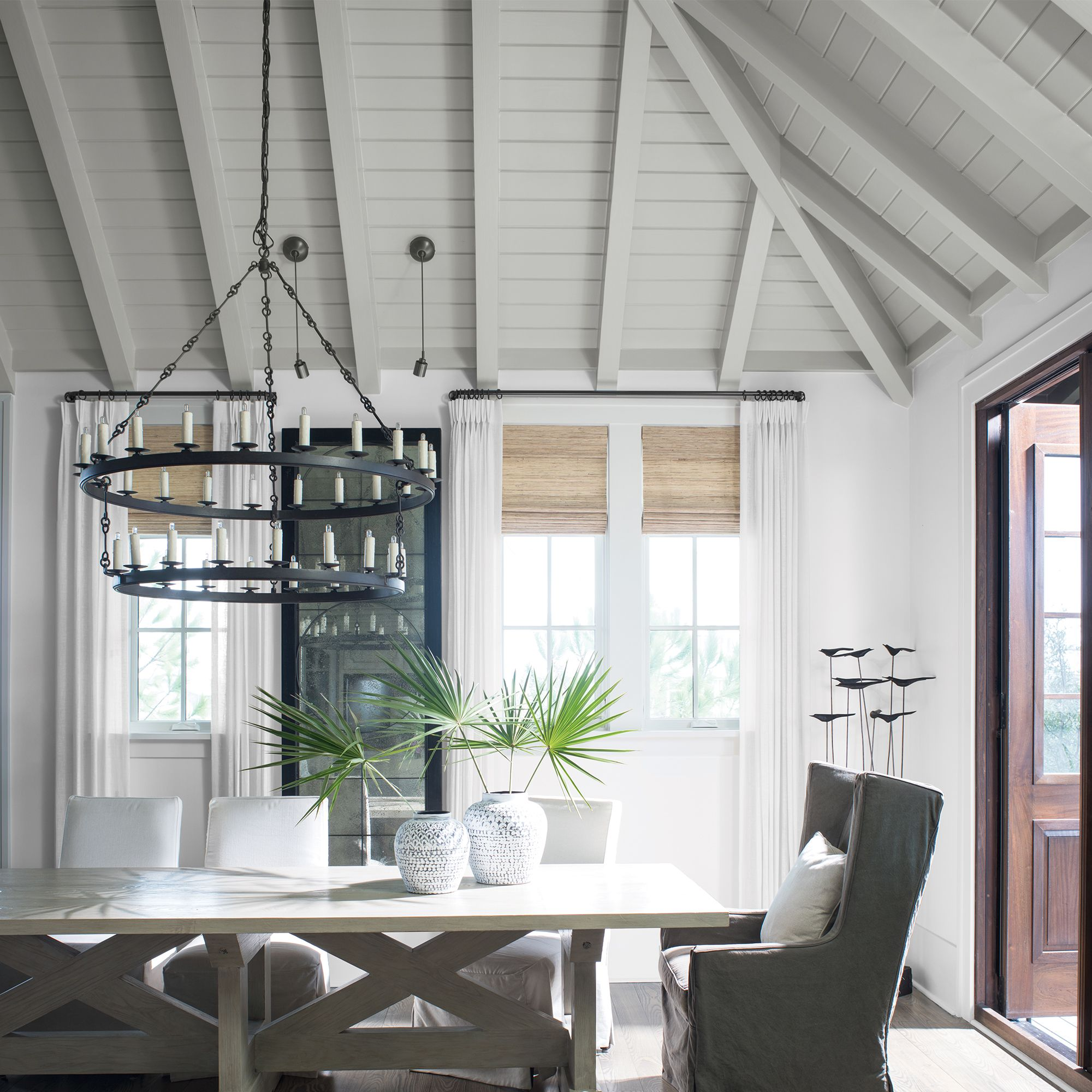 White Dining Room with Vaulted Ceiling