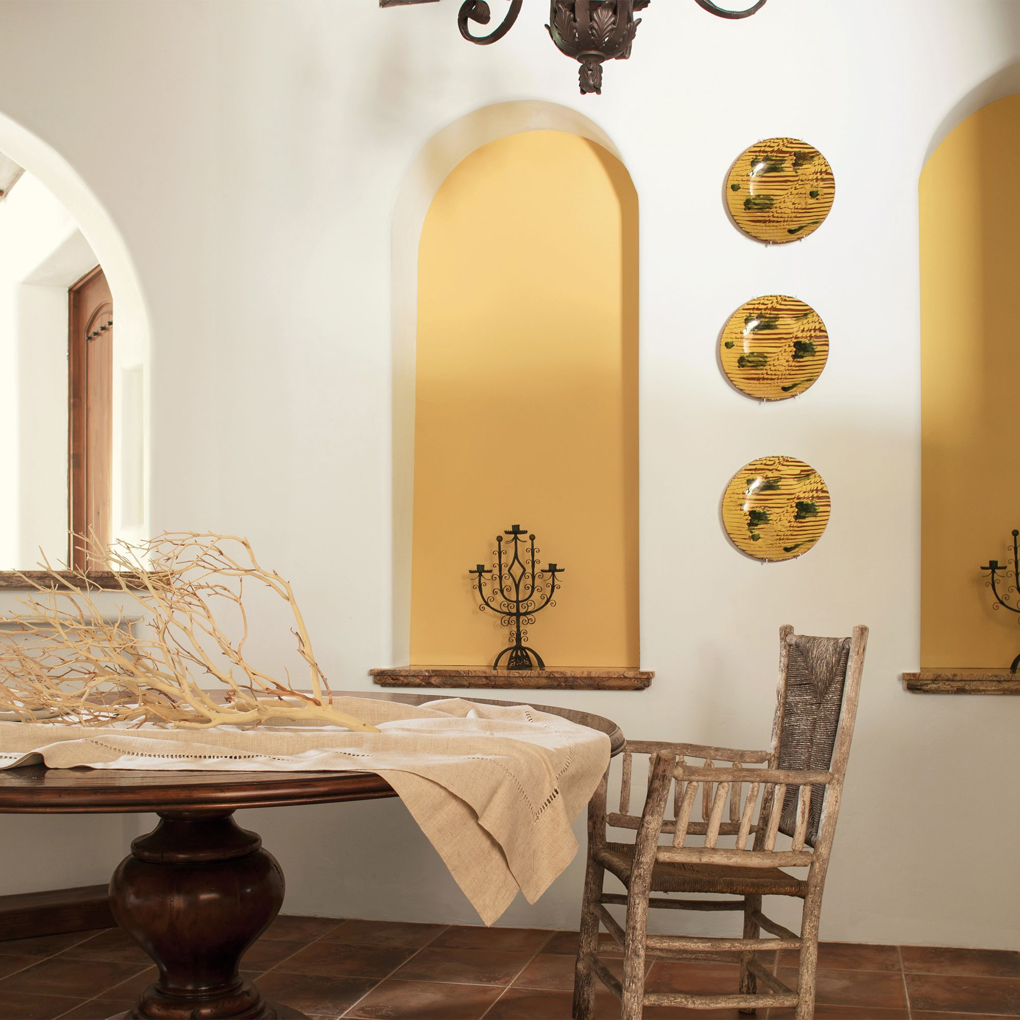 Yellow and White Dining Room with Chandelier