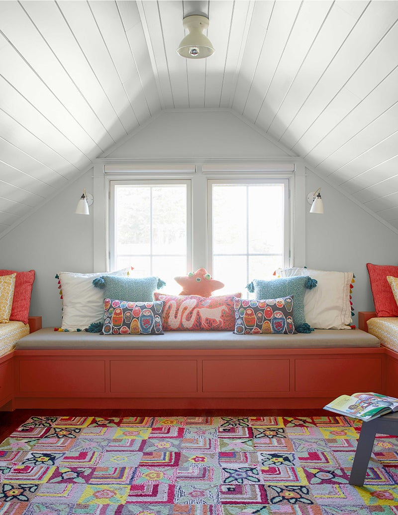 Benjamin Moore Paper White OC-55 paired with bright coral and aqua in a bedroom.