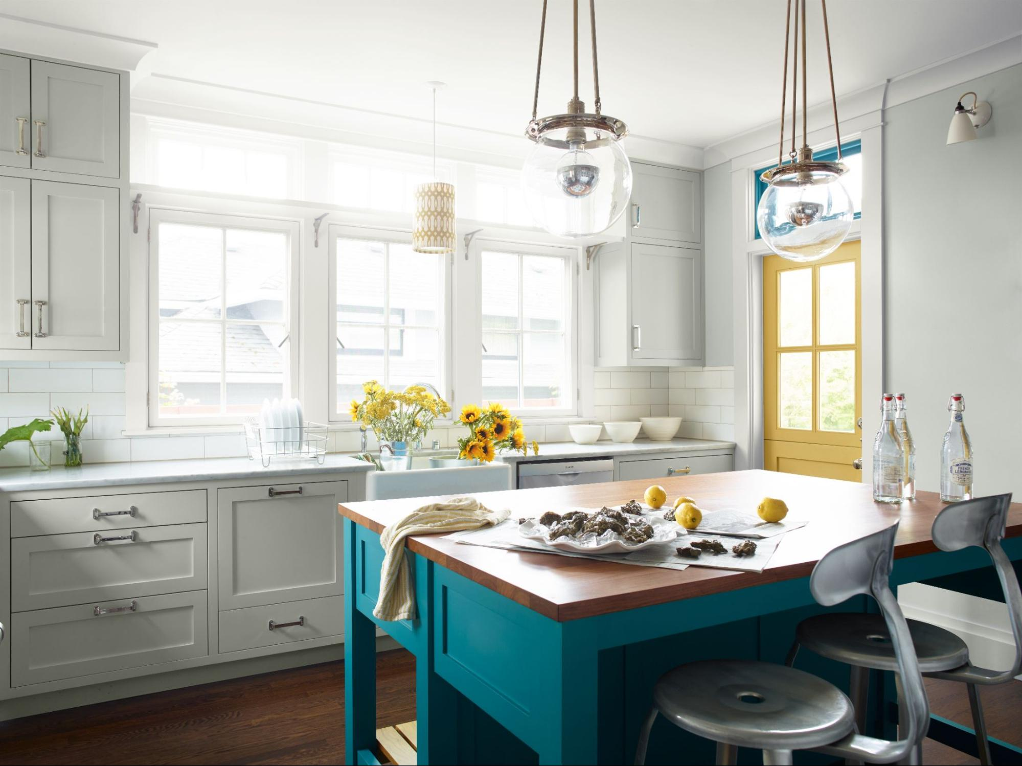 Benjamin Moore Paper White in the kitchen, complemented by bright accent colors.