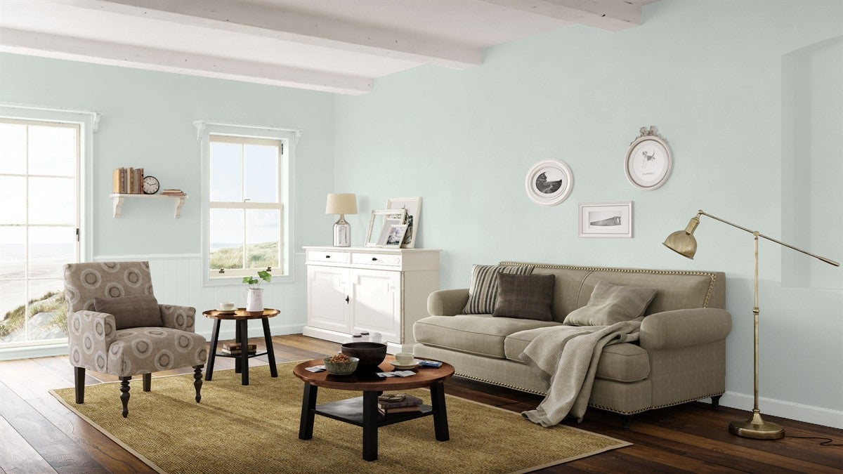 Benjamin Moore Beach Glass HC-1564 complements seaside views in the living room of a coastal cottage.