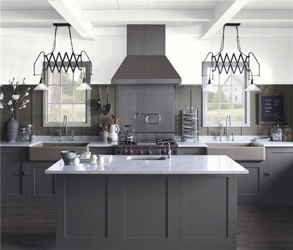 Benjamin Moore Super White on kitchen walls and enhances white quartz countertops and sleek appliances.